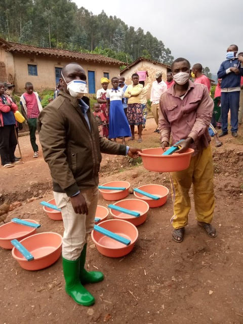 Pastor with water basins, soap and masks.